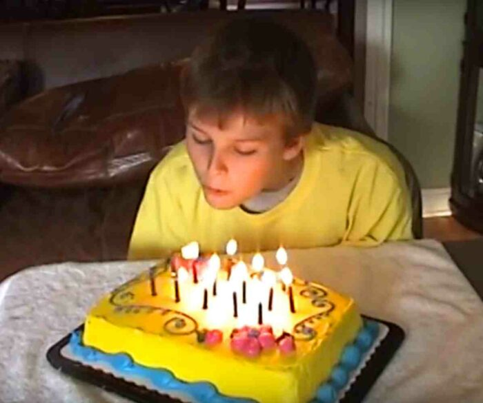 teen-with-birthday-party-cake